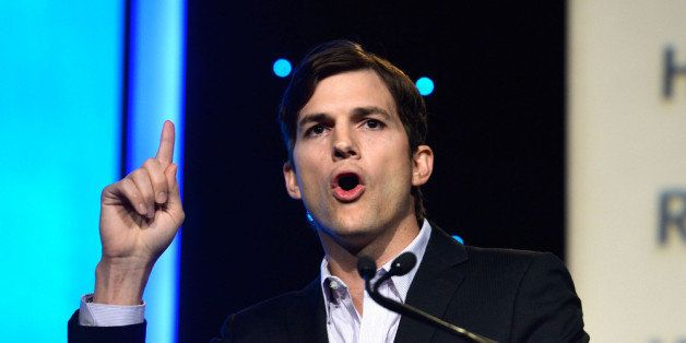 BEVERLY HILLS, CA - NOVEMBER 12:  Actor Ashton Kutcher speaks at the Human Rights Watch Voices For Justice Dinner at The Beverly Hilton Hotel on November 12, 2013 in Beverly Hills, California.  (Photo by Frazer Harrison/Getty Images)