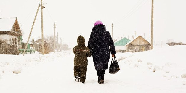 Mother and son walking in snow