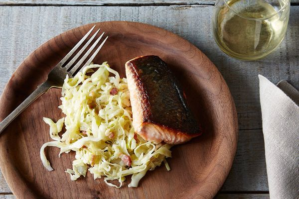 Yes, you can and should eat the skin. If prepared correctly, you'll get a nicely browned, thin and crunchy texture to play of