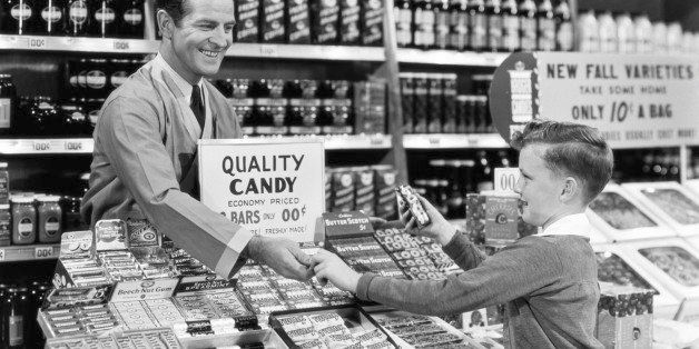 YOUNG BOY BUYING CANDY AT GROCERY STORE