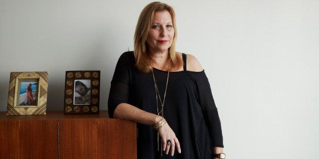 Paula Schneider, new chief executive officer of American Apparel Inc., stands for a photograph in her office at the company's factory in downtown Los Angeles, California, U.S., on Wednesday, Feb. 4, 2015. The company's spring marketing campaign will focus on the top 100 styles at American Apparel in a bid to remind consumers of all the basic items it offers - like a short black skirt and basic dresses - Schneider said. Photographer: Patrick T. Fallon/Bloomberg via Getty Images ** * Local Caption *** Paula Schneider
