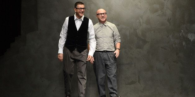 MILAN, ITALY - FEBRUARY 24:  Stefano Gabbana and Domenico Dolce acknowledge the applause of the audience after the runway at the Dolce & Gabbana fashion show as part of Milan Fashion Week Womenswear Fall/Winter 2013/14 on February 24, 2014 in Milan, Italy.  (Photo by Venturelli/WireImage)