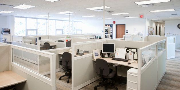empty office space with cubicles and natural light