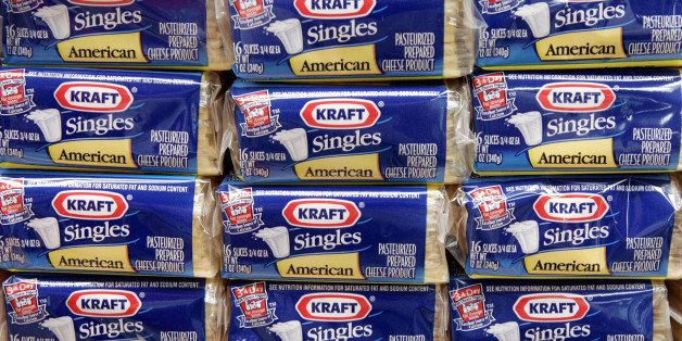 **FILE**  Packages of Kraft Singles are seen in this July 24, 2006 file photo, in Chicago.  Kraft Foods Inc., the nation's largest food and beverage maker, reported a second-quarter profit rise of nearly 4 percent on Monday, July 28, 2008, saying higher prices helped offset rising commodity costs. (AP Photo/Charles Rex Arbogast, file)