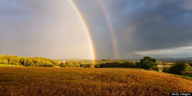 double rainbow rainbow in rural setting, over field in autumn after heavy thunder storm
