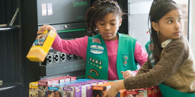 UPPER MARLBORO, MD - FEBRUARY 26:  Girl scouts sell cookies at Freeman's Barber Shop in Upper Marlboro, MD.  Lalah Williams, left, 10, of Upper Marlboro, MD, is helping sell the cookies, but has also utilized the internet to become one of the top sellers in the area.  Hilary Foinding, 9, of Upper Marlboro, MD is on the right.  (Photo by Sarah L. Voisin/The Washington Post via Getty Images)