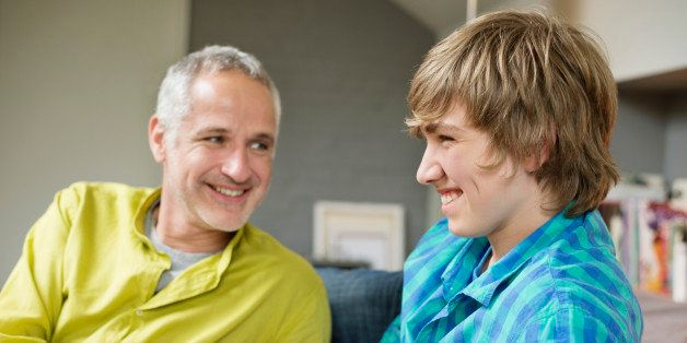 Man and his son smiling at home