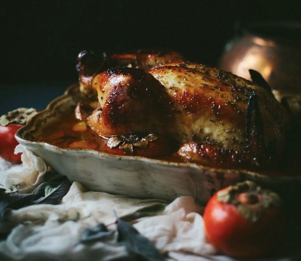 "<strong>Get the <a href=""http://www.adventures-in-cooking.com/2014/01/roast-chicken-with-persimmons-sage.html"" target=""_blank"