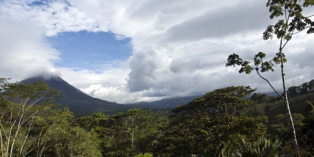 The Arenal Volcano's peak is often shrouded by clouds, Costa Rica.
