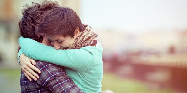 Romantic young couple hugging. Some motion blur in image.