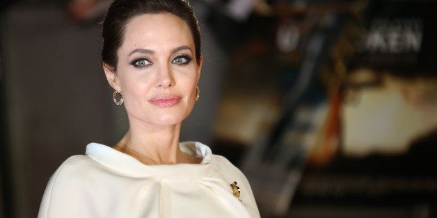 Actress Angelina Jolie poses for photographers upon arrival at the premiere of the film Unbroken in London, Tuesday, Nov. 25, 2014. (Photo by Joel Ryan/Invision/AP)