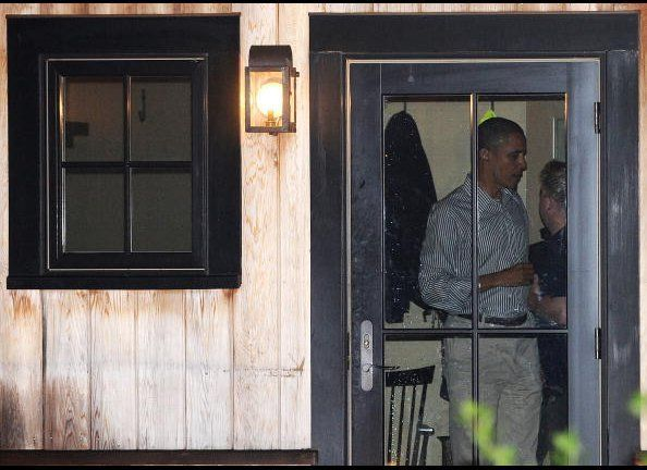 President Obama prepares to leave State Road restaurant after having dinner with First Lady Michelle Obama and other friends