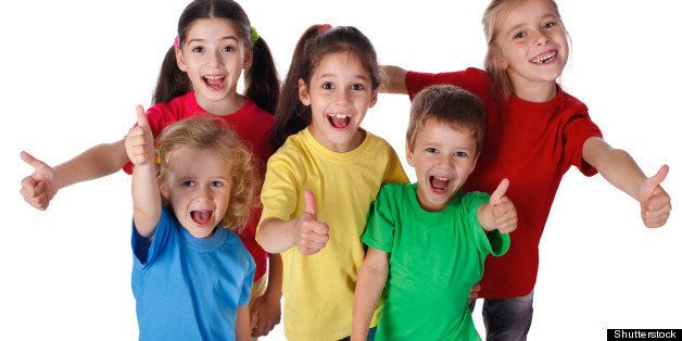 group of happy children with...