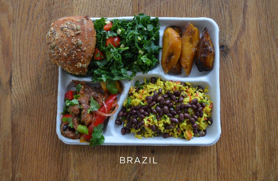 Pork with mixed veggies, black beans and rice, salad, bread and baked plantains.