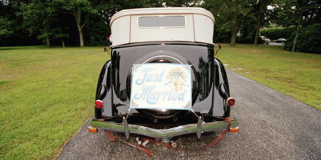 Vintage car with 'Just Married ' sign, rear view