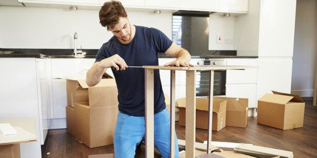 Man Putting Together Self Assembly Furniture In New Home On Both Knees