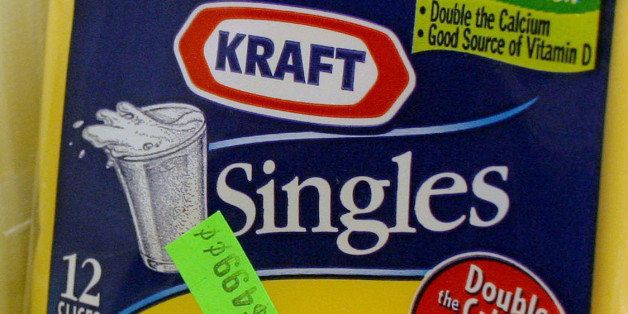 UNITED STATES - JANUARY 31:  Kraft Singles American cheese, manufactured by Altria Group Inc., is displayed in a store in New York, on Wednesday, January 31, 2007. Altria Group Inc., parent of the world's largest cigarette maker, will spin off Kraft Foods Inc. on March 30, saying the unit will grow more quickly as a independent company.  (Photo by John Marshall Mantel/Bloomberg via Getty Images)