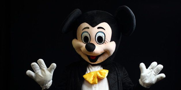 LONDON, ENGLAND - DECEMBER 28:  Darts fan Anthony Harrison dressed as Mickey Mouse poses ahead Day Eight of the William Hill PDC World Darts Championships at Alexandra Palace on December 28, 2014 in London, England.  (Photo by Jordan Mansfield/Getty Images)