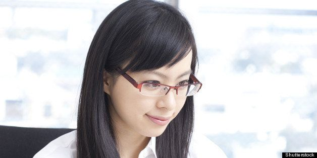 young business woman in glasses ...