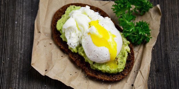 Rye toast with mashed avocado and poached egg