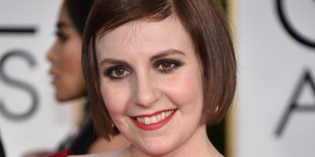 Lena Dunham arrives at the 72nd annual Golden Globe Awards at the Beverly Hilton Hotel on Sunday, Jan. 11, 2015, in Beverly Hills, Calif. (Photo by John Shearer/Invision/AP)