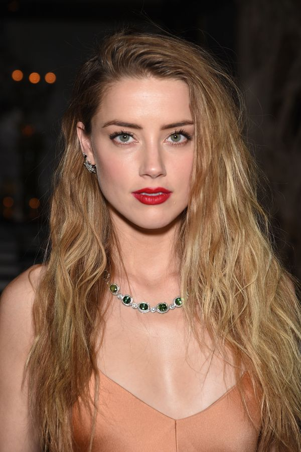 Take note. This look proves that beachy, wavy hair definitely has a place on the red carpet. Achieve this look by spritzing s
