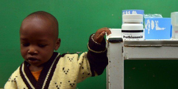 John, 3, who suffers from multi-drug-resistant tubeculosis (MDR-TB), waits by a medicine trolley for his medication to be prepared at a Medecins Sans Frontieres (MSF)-run clinic in Nairobi on March 24, 2015, World Tubeclosis Day. Globally, TB continues to kill 1.5 to 2 million people each year and remains the leading cause of death in people with HIV. In 2013, there were 90,000 new cases of TB diagnosed in Kenya and an estimated 20,000 cases went undetected. AFP PHOTO / TONY KARUMBA        (Photo credit should read TONY KARUMBA/AFP/Getty Images)