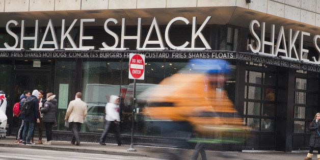 CHICAGO, IL - JANUARY 28:  A sign hangs over the entrance of a Shake Shack restaurant on January 28, 2015 in Chicago, Illinois. The burger chain, with currently has 63 locations, is expected to go public this week with an IPO priced between $17 to $19 a share. The company will trade on the New York Stock Exchange under the ticker symbol SHAK.  (Photo by Scott Olson/Getty Images)