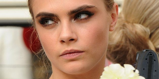 LONDON, ENGLAND - MAY 16:  Cara Delevingne attends her sister Poppy Delevingne's marriage to James Cook at St Paul's Church, Knightsbridge, on May 16, 2014 in London, England.  (Photo by Stuart C. Wilson/Getty Images)