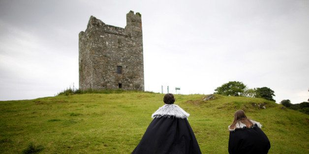 In this June 13, 2014 photo, Game of Thrones tourists visit Audleys field and castle, castleward, Strangford, Northern Ireland. Audleys field and castle was used for filming season 1 as King Robert Baratheon and his retinue arrive at Winterfell. (AP Photo/Peter Morrison)
