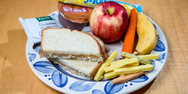 JAMAICA PLAIN, MA - SEPTEMBER 5: Colleen Scanlan's prepared school lunch for her two sons, photographed at their home in Jamaica Plain. Clockwise from bottom left - Peanut butter sandwich, chocolate brownie, pudding, yogurt, an apple, carrot, banana, and veggie straws. (Photo by Aram Boghosian for The Boston Globe via Getty Images)