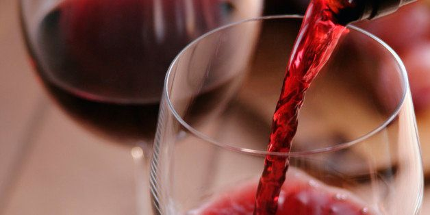 Red wine pouring into wineglass
