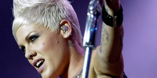 US-singer Pink alias Alecia Beth Moore performs on the main stage, during the Paleo music open air Festival in Nyon, Switzerland, Thursday, July 26, 2007. (KEYSTONE/Martial Trezzini)
