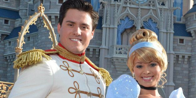LAKE BUENA VISTA, FL - JUNE 24:  In this handout photo provided by Disney Parks, singer Ariana Grande (R) poses with Cinderella and Prince Charming in front of Cinderella Castle in the Magic Kingdom June 24, 2014 in Lake Buena Vista, Florida.  Grande is celebrating her 21st birthday with dozens of family and friends at Walt Disney World.  (Photo by Chloe Rice/Disney Parks via Getty Images)