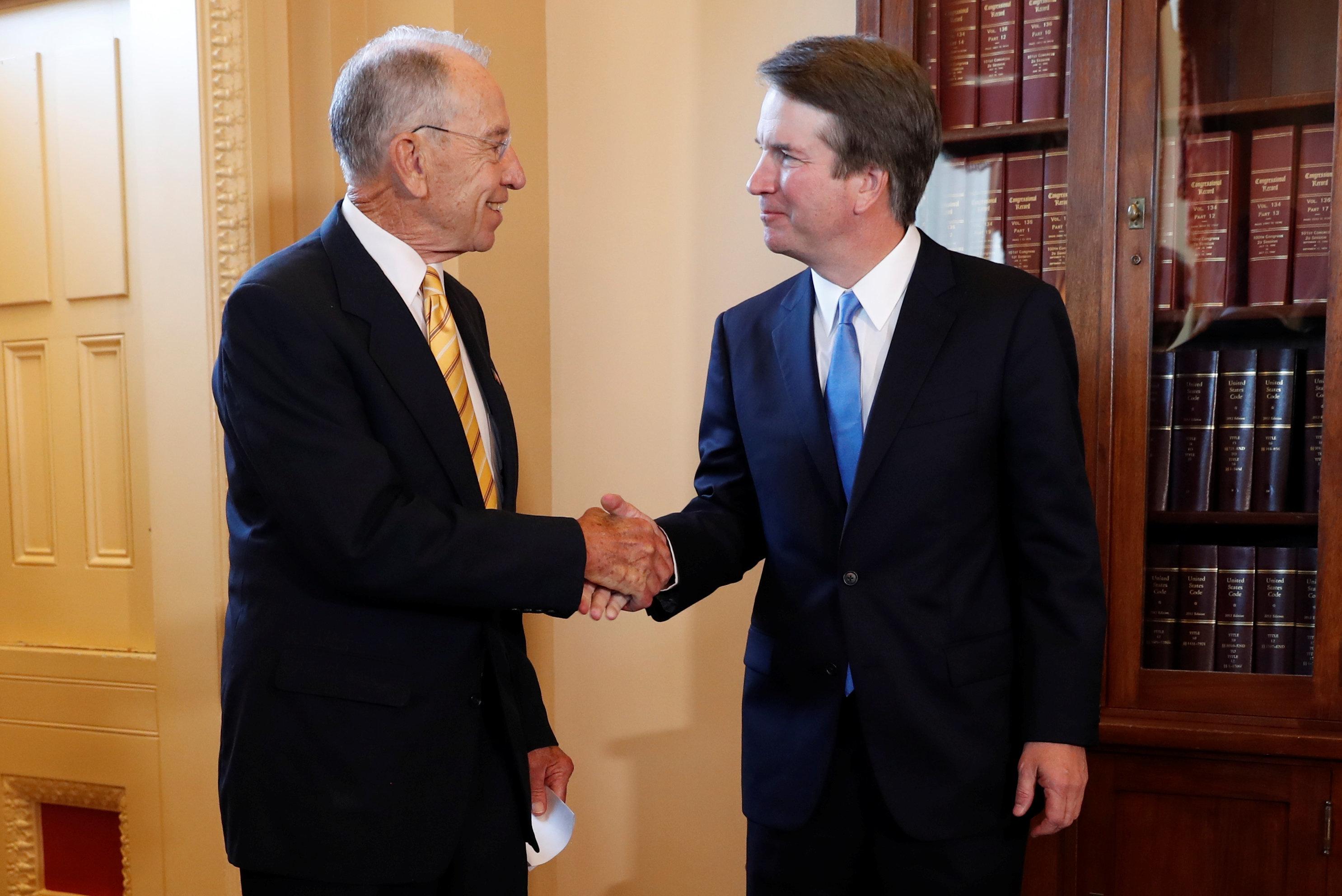 U.S. Senate Judiciary Committee Chairman Senator Chuck Grassley greets Supreme Court nominee Judge Brett Kavanaugh before a meeting at the U.S. Capitol on Capitol Hill in Washington, U.S., July 10, 2018. REUTERS/Leah Millis