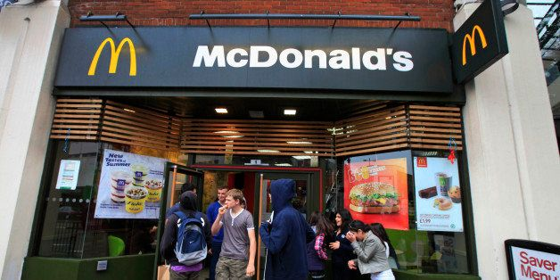 Youths gather outside a McDonald's restaurant in London, Sunday, Sept. 4, 2011.  About 1,200 McDonald's restaurants in Britain will begin displaying the calorie count of each food and drink item on their wall-mounted menu boards this week, as part of a government-led program to fight obesity and promote healthier eating, the chain said Sunday. McDonald's already puts calorie information on its Web site and the back of its tray liners, but this is the first time the figures will be displayed prominently in its restaurants outside the U.S. The chain has similar calorie menu boards in New York City, which became the first in the U.S. to put a calorie posting law in place in 2008.The British program is voluntary, and relies on partnering companies to fulfill their health pledges. Other chains that have signed up to the British Department of Health calorie display program include Kentucky Fried Chicken, Pizza Hut and Starbucks. (AP Photo/Lefteris Pitarakis)