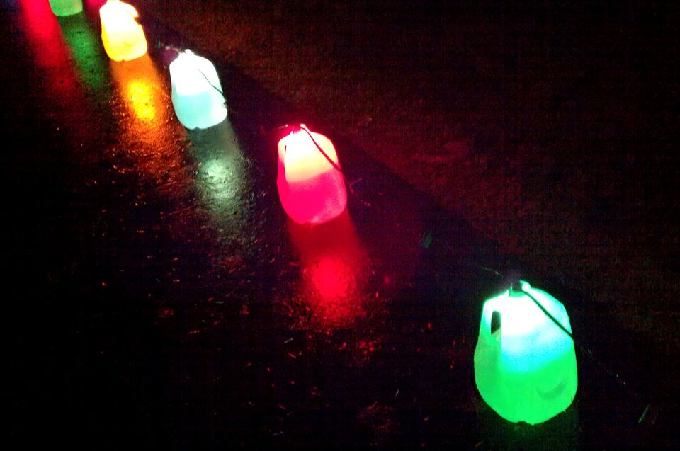 """To make milk jug lanterns, stick a string of colored lights in empty milk jugs. No <a href=""""http://www.electriciansnetworks.c"""