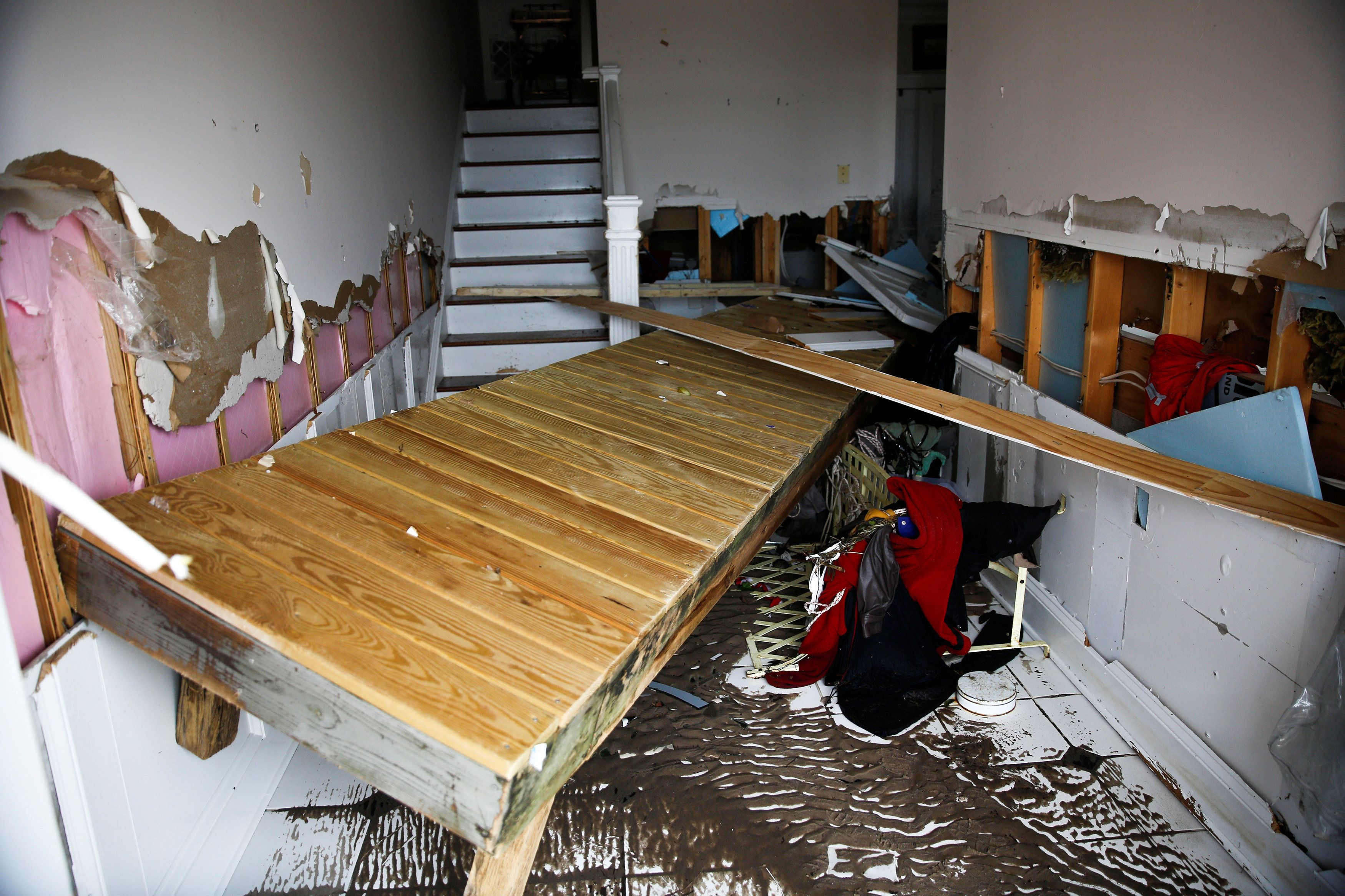 Part of a dock remains inside of a house as people clean their properties after the pass of Hurricane Florence in New Bern, N