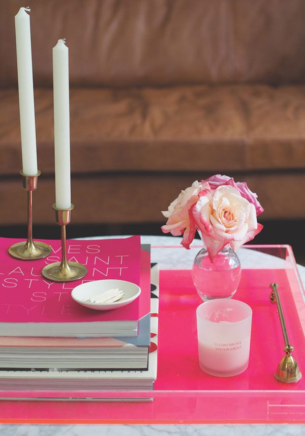 No matter your tastes, there are a few essentials that always look good on a coffee table tray: a stack of three books -- or