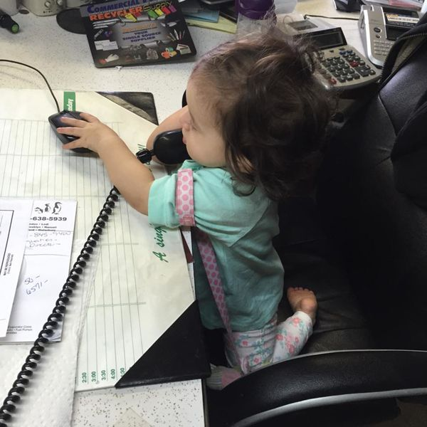 """""""This is my sweet baby girl, sitting at mommy's desk, pretending to be hard at work!"""""""