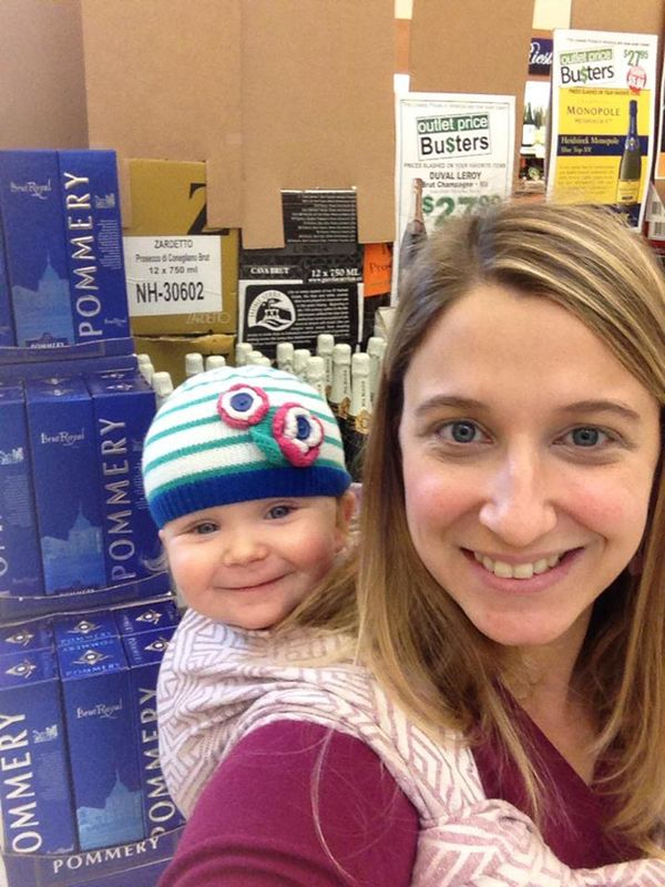 """""""Had to bring my daughter to work. She helped me set up my wine displays."""""""