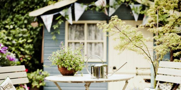 Garden Table and Chairs with Small Summer House Behind