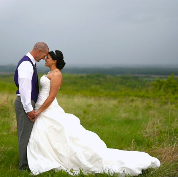 """""""Storm season in Kansas means dodging thunderstorms for bride and groom portraits."""" - Salt and Pine Photography"""