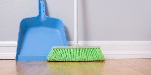 spring cleaning broom against...
