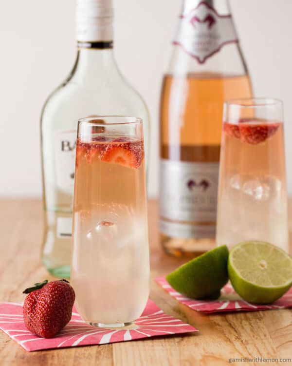 "<strong>Get the <a href=""http://www.garnishwithlemon.com/bubbly-strawberry-mojitos/"" target=""_blank"">Bubbly Strawberry Mojito"