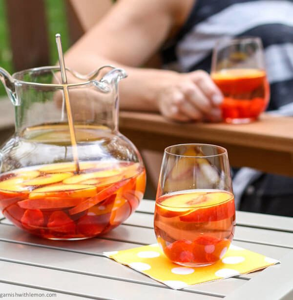 "<strong>Get the <a href=""http://www.garnishwithlemon.com/peach-rose-sangria/"" target=""_blank"">Peach Rosé Sangria recipe </a>f"