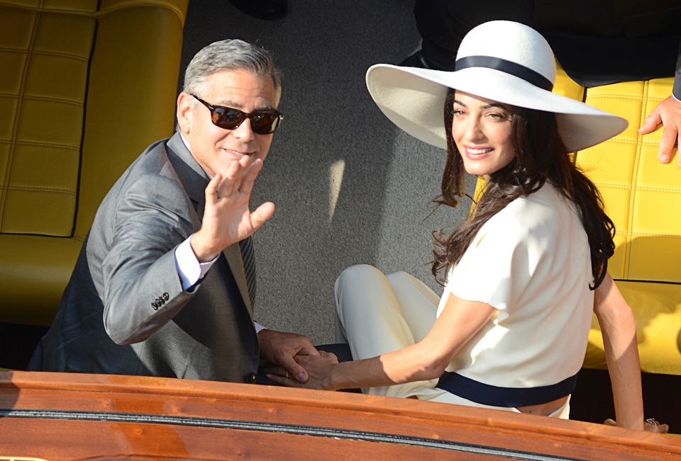 George Clooney and Amal Alamuddin leave the city hall after their civil marriage ceremony in Venice, Italy, on Sept. 29, 2014