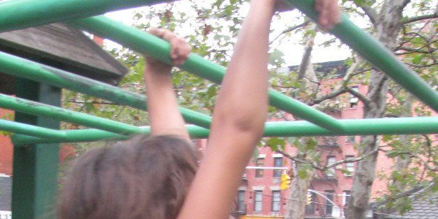 Eden on her way across the monkey bars at First Park.