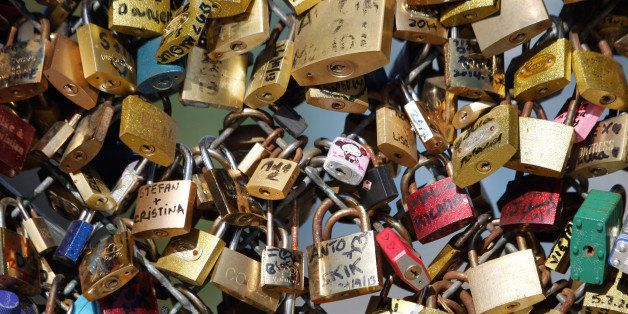 FILE - This April 9, 2014 file photo shows love locks fixed on the Pont des Arts bridge in Paris, France. Any hope that the love locks that cling to Parisᅢ까タᅡル famed Pont des Arts bridge would last forever _ will be unromantically dashed by the city council who plan to dismantle them Monday _ for good. (AP Photo/Thibault Camus, File)