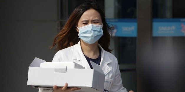 SEOUL, SOUTH KOREA - JUNE 02:  A hospital worker wearing mask near a quarantine tent for people who could be infected with the MERS virus at Seoul National University Hospital on June 2, 2015 in Seoul, South Korea. The Ministry of Health and Welfare of South Korea confirmed two deaths from Middle East Respiratory Syndrome (MERS) on June 2, 2015. It reported six new cases of MERS, raising the number of confirmed local patients to 25. The first case was confirmed on May 20.  (Photo by Chung Sung-Jun/Getty Images)